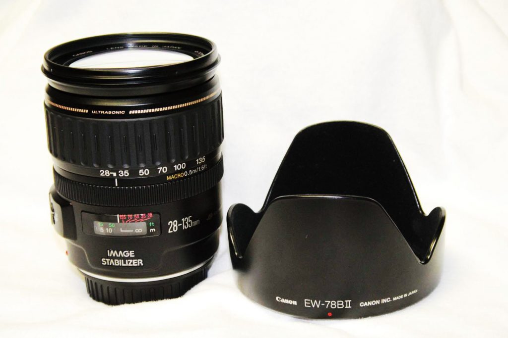The Canon EF 28-135mm IS UISM, with Lens hood. A must have accessory, if you want to shoot on sunny days.