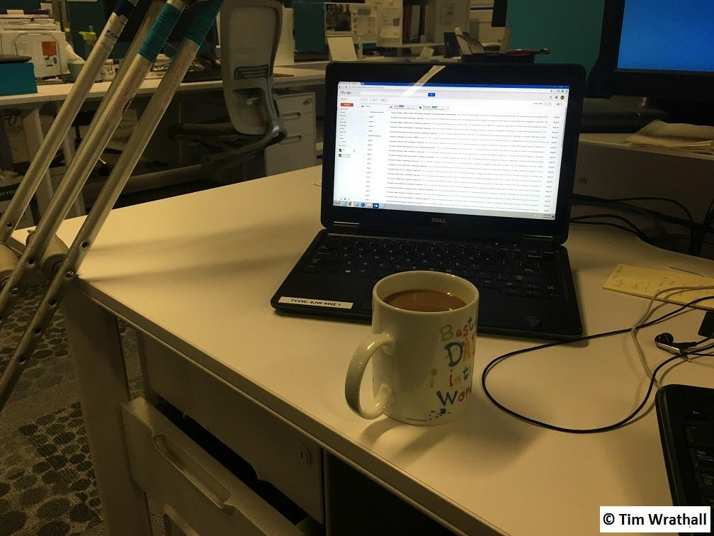 Day 1, back in the Office. Laptop, Coffee and Crutches.